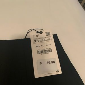 NWT Black mini skirt! In perfect condition.